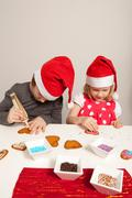 girls decorating gingerbread cookies - stock photo