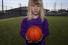 girl with a basketball - stock photo
