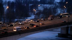 Pan-right shot of early morning traffic on bridge Stock Footage