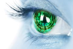 eye iris and electronic circuit - stock photo