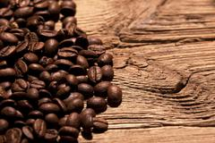 fresh coffee beans on wood - stock photo