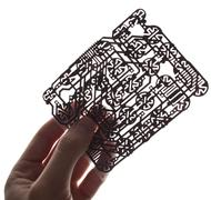 holds in a hand a  circuit board on a white background - stock photo
