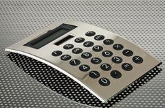 Silver calculator on the grid Stock Photos