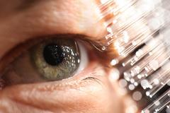 Fiber optics amd eye technology Stock Photos