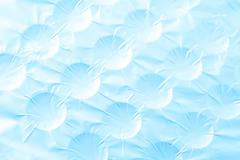 Abstract crumpled silver aluminum foil closeup background texture, in blue Stock Photos