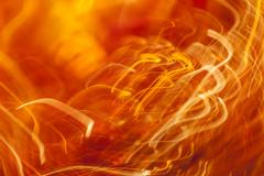 Orange light streaks abstract background Stock Photos