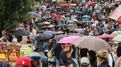Berlin Mauerpark karaoke canceled because of rain, Big crowd in rain Stock Footage