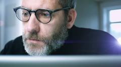 Mature man works with laptop Stock Footage