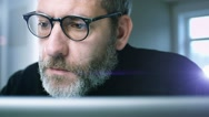 Stock Video Footage of Mature man works with laptop
