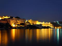 Night view on palace and lake in udaipur Stock Photos