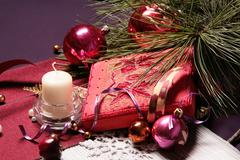 beautiful christmas composition: red balls, candle, fir-tree branch, casket - stock photo