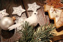 photo of white pigeon near different christmas objects - stock photo