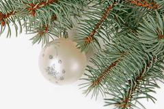 green twig of fir-tree with christmas ball - stock photo