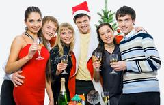 Portrait of six friends huging on the background of christmas tree Stock Photos