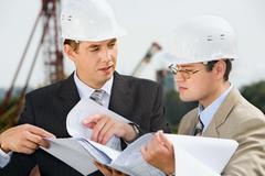 Stock Photo of successful architect is explaining  a conditions of project to the customer