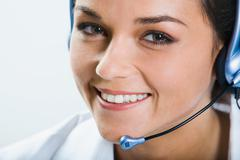 portrait of  beautiful smiling telephone operator with headset - stock photo