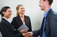 Stock Photo of business people shaking hands in the office