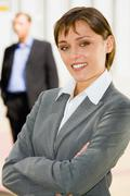 Portrait of pretty woman smiling in a business environment Stock Photos