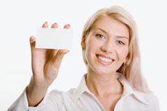 Young beautiful woman presenting her business card Stock Photos
