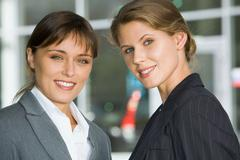 portrait of two confident young woman looking at camera - stock photo