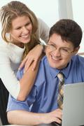 Business man and business woman are discussing an new ideas in the office Stock Photos