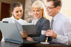 confident business people are working together at meeting - stock photo