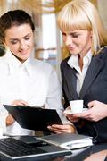 portrait of two strong women interacting at business meeting - stock photo