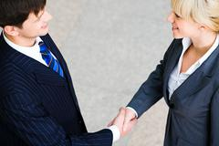 creative image of people shaking hands making an agreement - stock photo