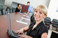 confident smiling specialist looking at camera in the boardroom - stock photo