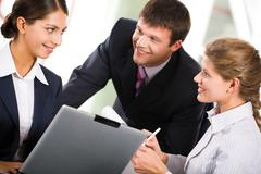 Stock Photo of portrait of three  white collar worker interacting at business meeting