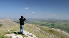 Man looking with binocular - stock footage