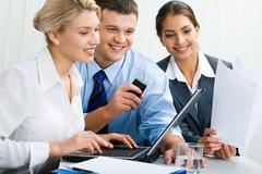 Stock Photo of business team of three people are discussing an ideas