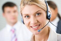 Face of young charming confident woman with headset Stock Photos