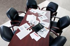 Image of large table and six black chairs in the boardroom Stock Photos