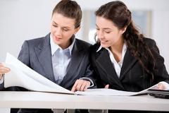 two business women working together in the office - stock photo