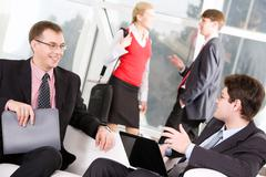 portrait of  business men negotiating with each other on the background of peopl - stock photo