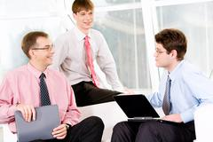 image of three entrepreneurs communicating with each other - stock photo