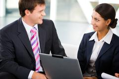 confident business people are discussing business strategy in the office - stock photo