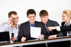 business team of four people discussing a new ideas - stock photo