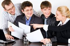 Photo of successful professionals interacting with each other Stock Photos