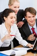 group of three business people working together - stock photo