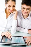 Portrait of business woman and man reading a text on workplace Stock Photos