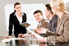 Portrait of business people discussing a new strategy at a seminar Stock Photos