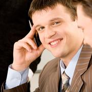 close-up portrait of handsome young man in a business suit - stock photo
