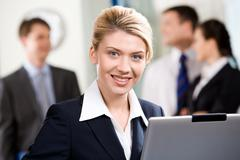 portrait of successful specialist with wonderful smile in a office environment - stock photo