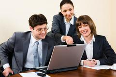business woman is explaining the correct way of analysis to her colleagues in  t - stock photo