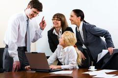 Three women listen to the man which gives them the instruction Stock Photos