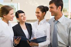 four successful business people discuss the ideas - stock photo