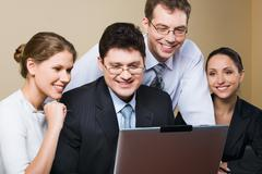 successful business team is  reading an advantageous offer from one of the busin - stock photo