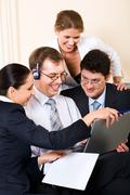 young successful business people gathered together around the laptop discussing - stock photo
